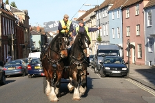 Tom (left) at work in Devizes before he retired.